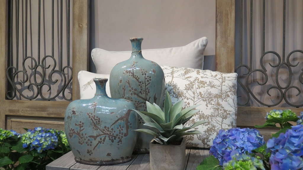 Blue Vases, Pillows, and Wall Decor