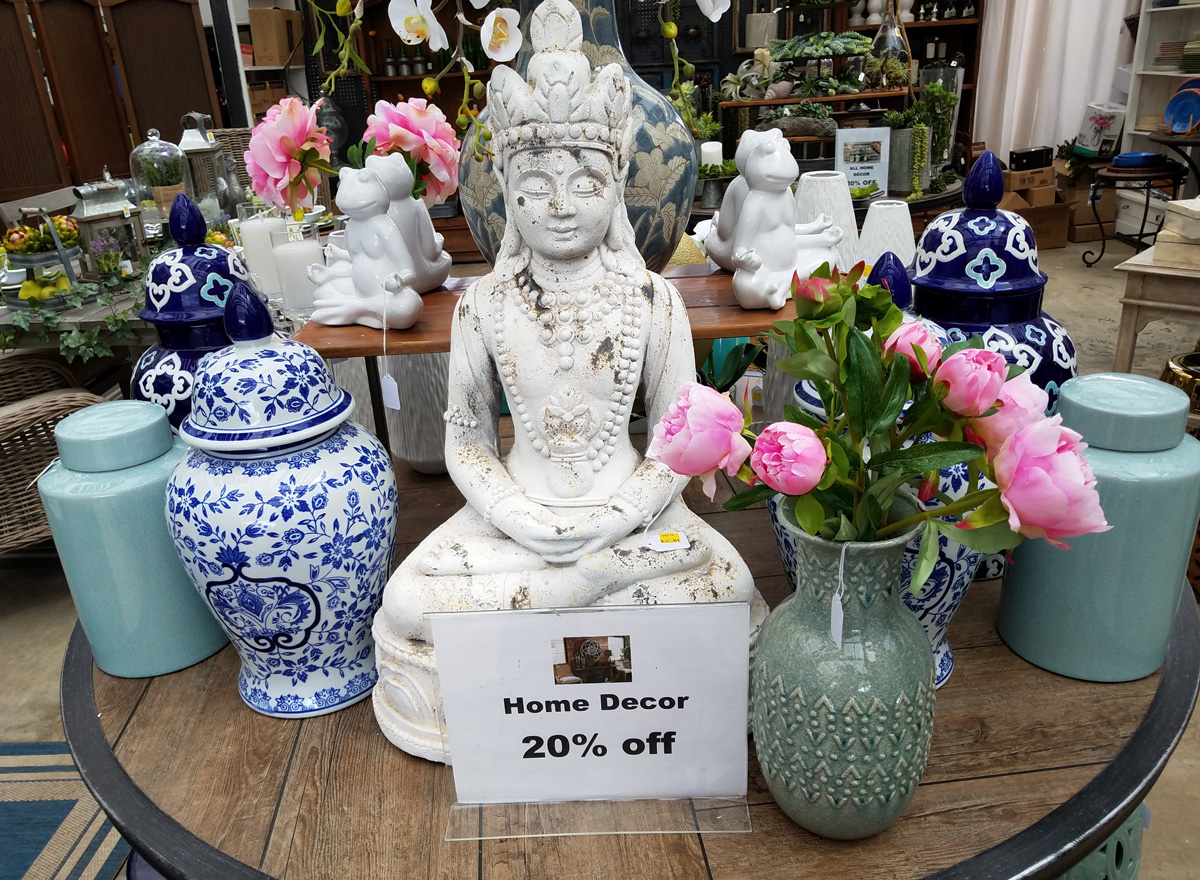 Buddha Statue with vases, flowes, and figurines