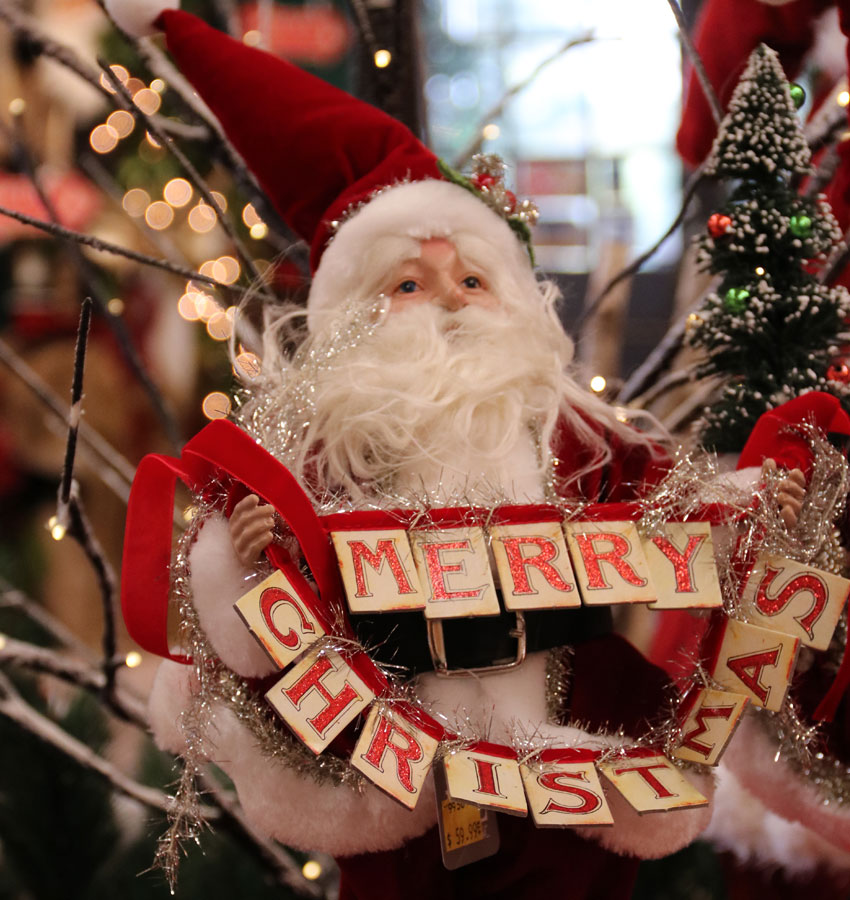 Santa Figurine with Merry Christmas Sign