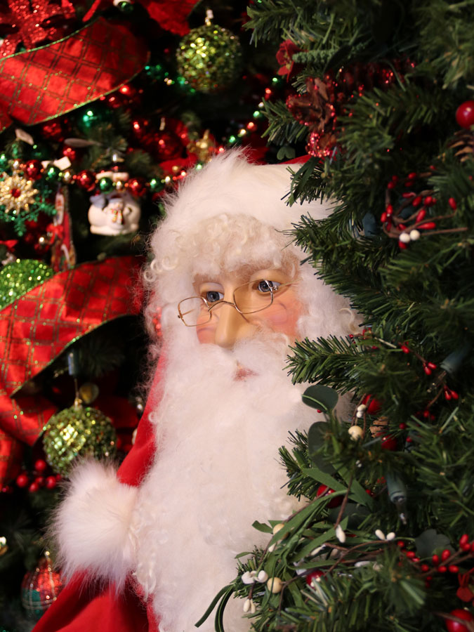 Decorated Artificial Christmas Tree and Large Santa