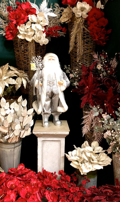 Santa Figurine with Artificial Flowers