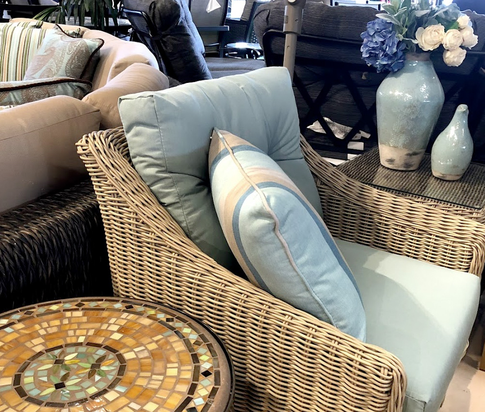 Cambria Wicker Chair with matching throw pillow and mosaic end table