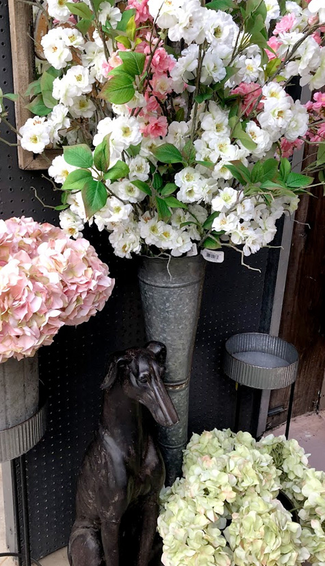 Flowers in Rustic Metal Stands and Greyhound Statue