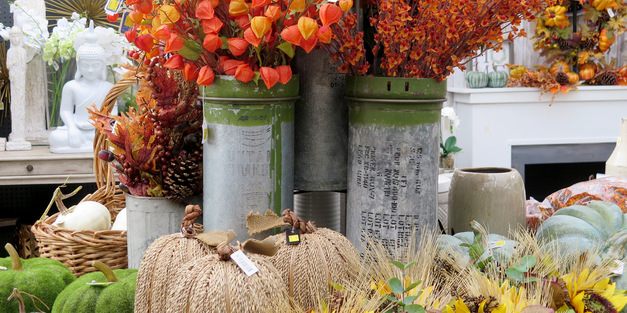 Faux flowers and pumpkins in a gorgeous Fall display