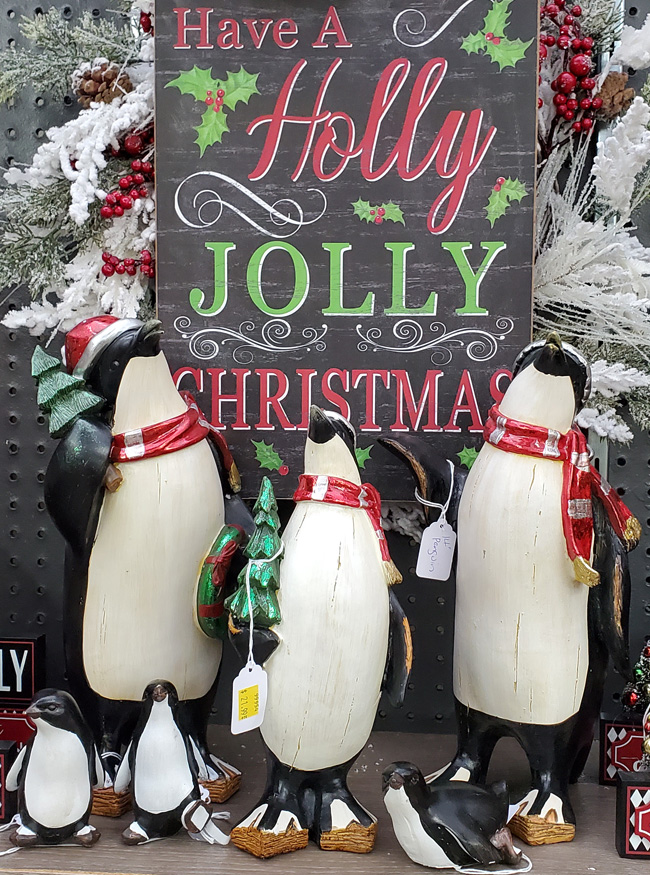 Christmas Penguin Figurines and Painted Chalkboard Sign