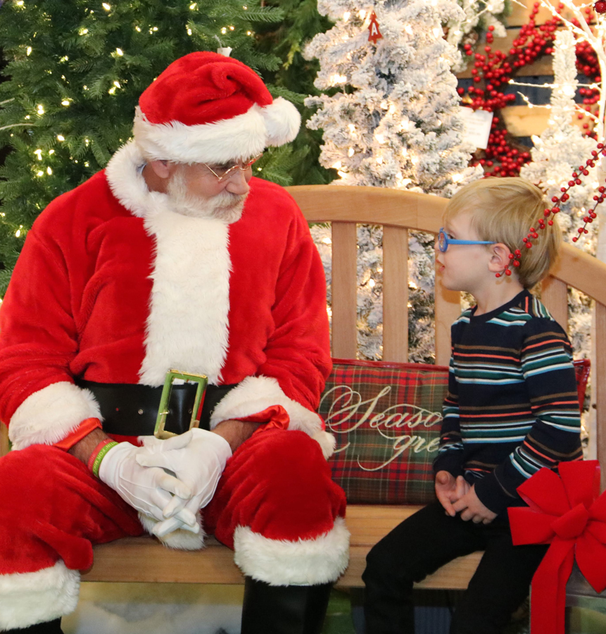 Santa with a Child at Down to Earth