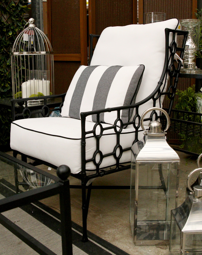 Indoor/Outdoor chair with throw pillow and decorative lanterns