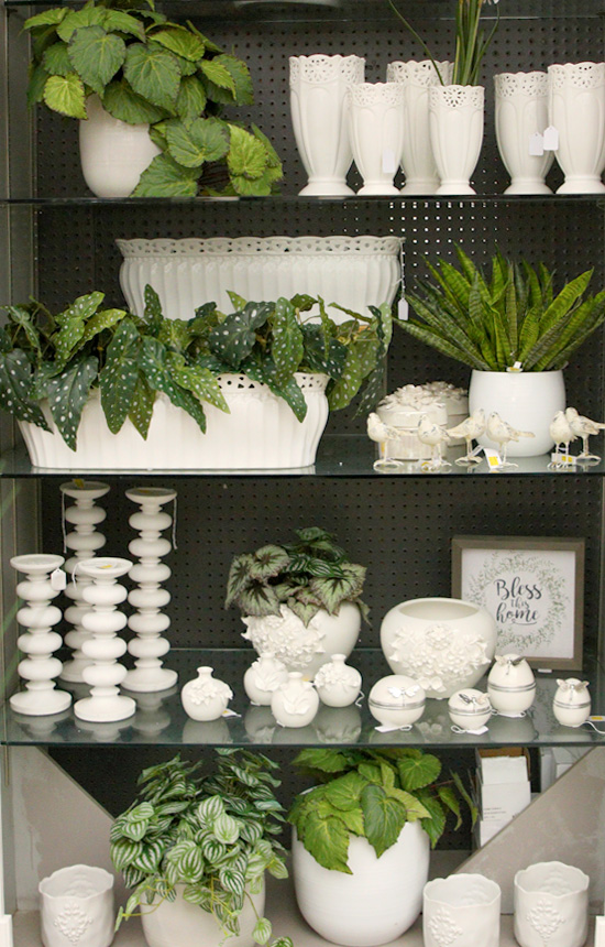 A huge selection of white ceramics and faux plants